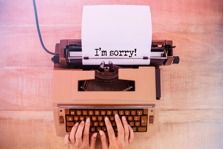 i am sorry: The sentence I am sorry against white background against above view of old typewriter