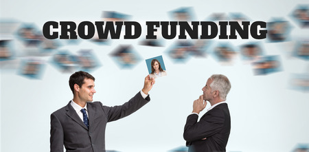 The word crowdfunding against white background against businessmen working together photo