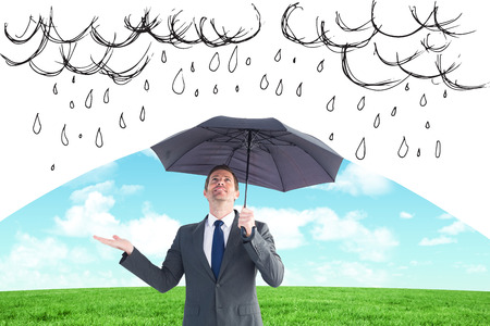 mid thirties: Composite image of man protecting from the rain with umbrella