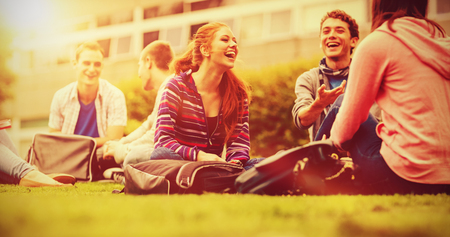 Group of young college students sitting in the park Stock Photo