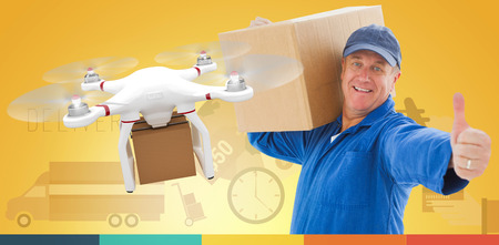 boiler suit: Happy delivery man holding cardboard box against drone holding a cardboard