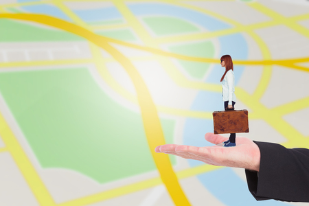well dressed woman: Side view of a smiling hipster woman holding suitcase against navigation map