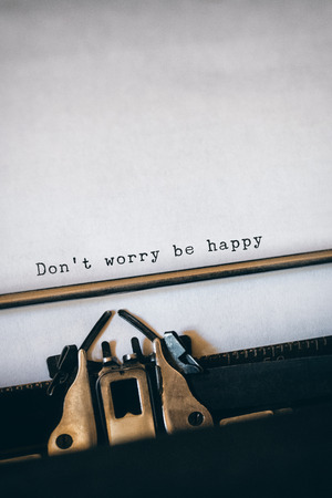 dont worry: Dont worry be happy message on a white background  against close-up of typewriter