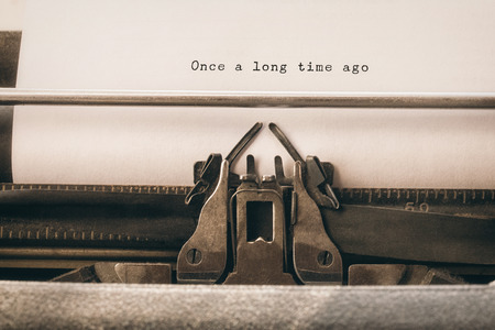 long  ago: Once a long time ago message on a white background against close-up of typewriter Stock Photo
