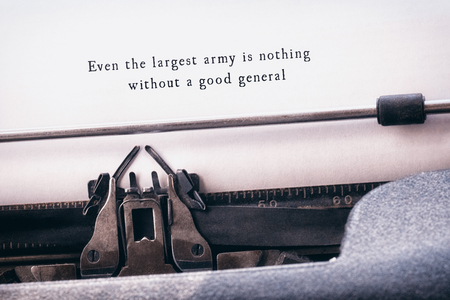 even: Even the largest army is nothing without a good general message on a white background against close-up of typewriter