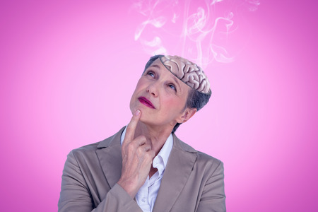 outraged: Businesswoman thinking against pink background