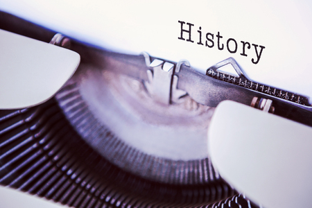 redhair: History message on a white background against a printer Stock Photo