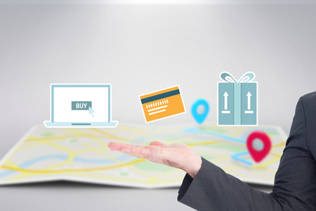 mid adult men: Businessman with his hand out against digital shopping online diagram on a white background
