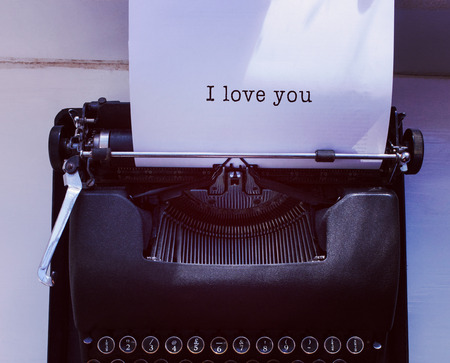 part of me: I love you message on a white background against womans hand typing on typewriter Foto de archivo