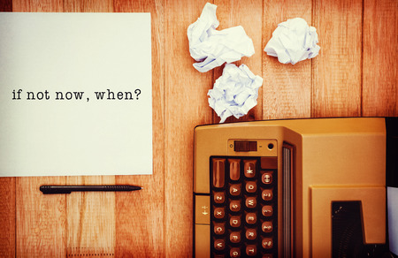 when: If not now, when? message on a white background  against view of an old typewriter and paper