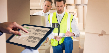 delivery driver: Man using tablet pc  against delivery driver checking his list on clipboard Stock Photo