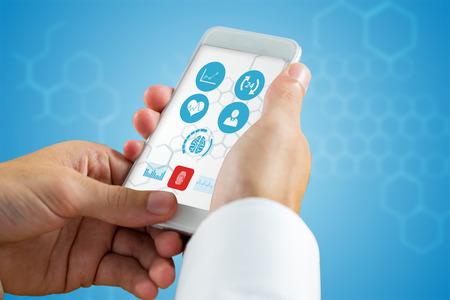 chemical structure: hand holding smartphone against chemical structure in blue and white