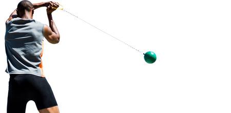 hammer throw: Rear view of sportsman practising hammer throw Stock Photo