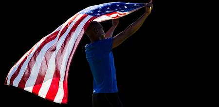 raise the white flag: Rear view of sportsman raising an american flag Stock Photo