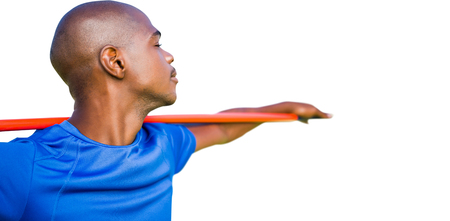 holding close: Close up of sportsman holding a javelin Stock Photo