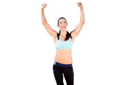 legging: Sporty woman raising her arms
