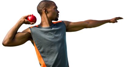 shot put: Vista de perfil de deportista practicando lanzamiento de peso