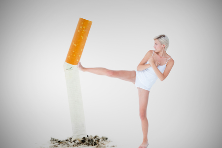 crossed cigarette: Pretty woman raising her leg  against image of pressed cigarette on a white background