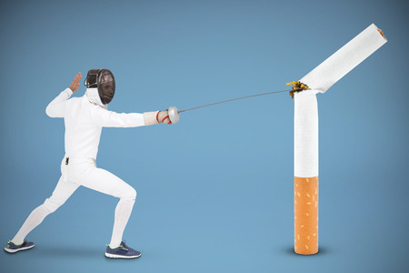 fencing sword: Man wearing fencing suit practicing with sword against blue background