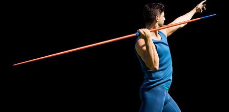 rear view: Rear view of sportsman practising javelin throw