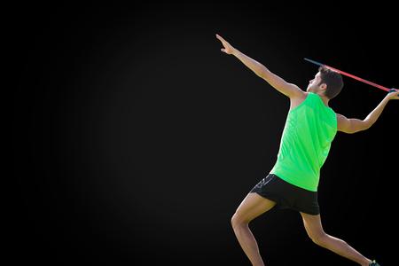 lanzamiento de jabalina: Profile view of sportsman practising javelin throw