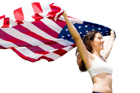 profile view: Profile view of sportswoman is raising an american flag Stock Photo