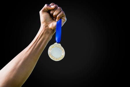 silver medal: Hand holding a silver medal on white background