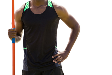 holding close: Close up of athletic man holding a javelin Stock Photo
