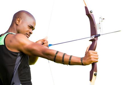 practising: Side view of sportsman practising archery