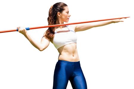 lanzamiento de jabalina: Vista frontal de la deportista está practicando el lanzamiento de jabalina Foto de archivo