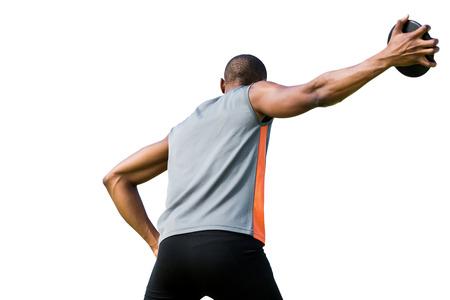 lanzamiento de disco: Bajo el ángulo de deportista está practicando el lanzamiento de disco