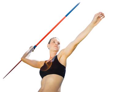 lanzamiento de jabalina: Bajo el ángulo de la deportista está practicando el lanzamiento de jabalina