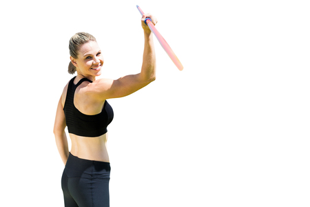 javelin: Rear view of sporty woman holding a javelin