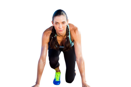 starting block: Sporty woman in the starting block