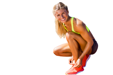 shoelace: Sporty woman doing her shoelace Stock Photo