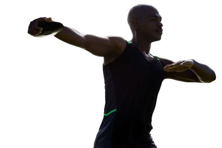 lanzamiento de disco: Dark picture of sportsman is practising discus throw