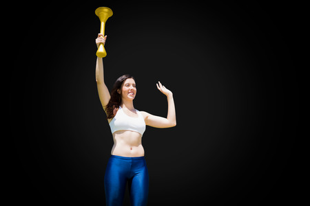 front raise: Front view of sportswoman raising a cup Stock Photo