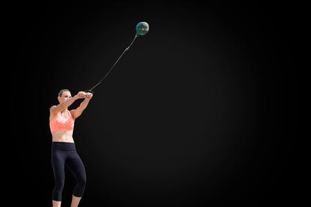 hammer throw: Portrait of sportswoman practising hammer throw