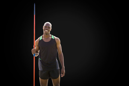 javelin: Front view of happy sportsman is holding a javelin