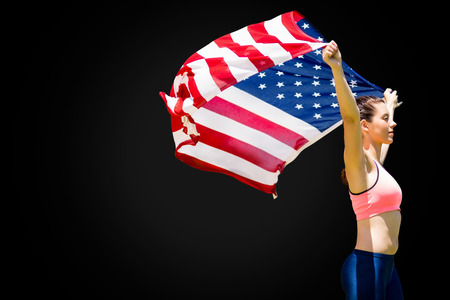 profile view: Profile view of sportswoman raising an american flag