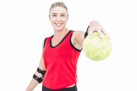 elbow pad: Female athlete with elbow pad holding handball on white background