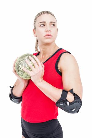 female elbow: Female athlete with elbow pad holding handball on white background