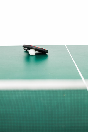pursuits: tabble tennis equipment on white background