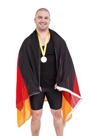 bandera de alemania: Atleta con una medalla de oro con el indicador de Alemania en el fondo blanco