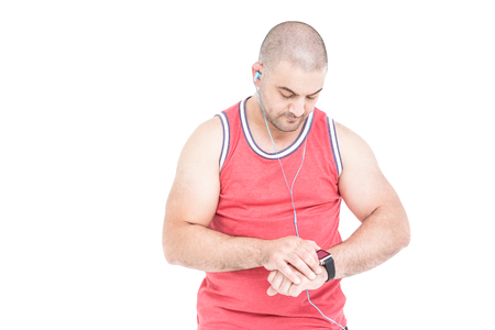 cut wrist: Athlete checking time in his wristwatch on white background