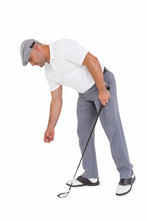 picking up: Golf player picking up golf ball on white background Stock Photo
