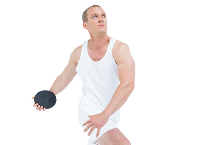exercices: Sportsman throwing shot put on white background Stock Photo