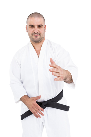 gesturing: Portrait of fighter gesturing on white background Stock Photo