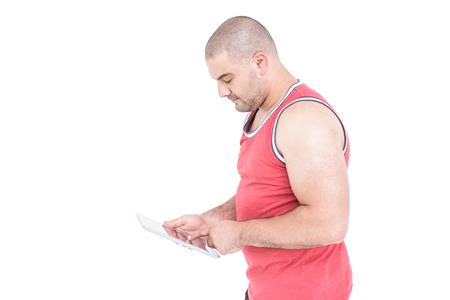 cut out device: Athlete using digital tablet on white background