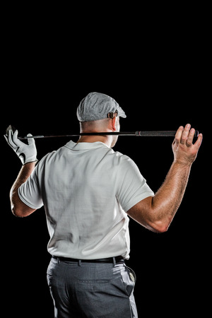 cut the competition: Rear view of golf player holding a golf club on white background